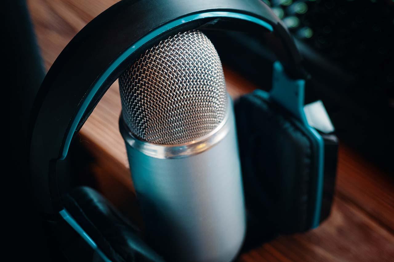 Podcast studio. Pro Headphones on professional microphone